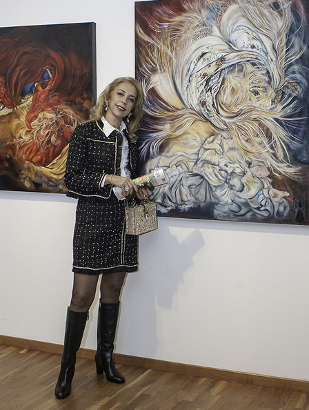 Mimi Ilouz and her paintings.jpg